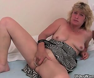 Granny in heat finger fucks her old pussy
