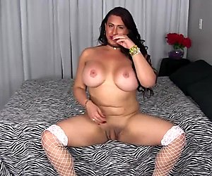 Busty shemale in stockings wanking her dick