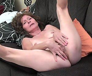 Sleazy grandma with saggy tits finger fucks