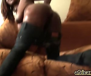 Slim African beauty bends over and gets slippery pussy filled with meaty white cock
