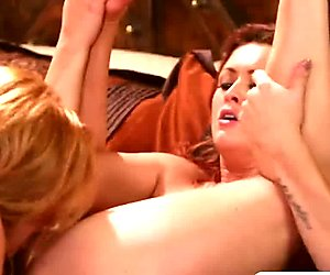 Marie McCray and Karlie Montana pleasure each other on the bed