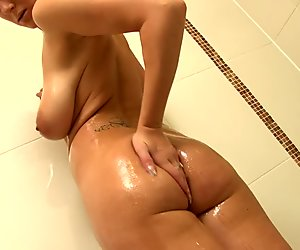 Big breasted Demi suds herself in the shower