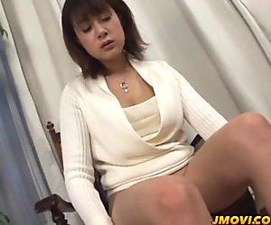 Shinobu Mizushima massages her huge boobs and gives a hot blowjob