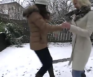 Girlfriends play in snow before warming up with hot lesbian sex
