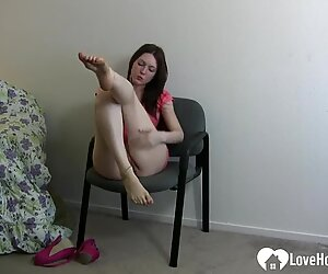 Sitting on a chair in her provocative dress