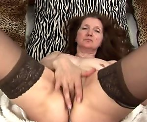 Mature GILF playing with her toy