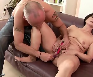 Granny Margo T. gets pleasured on couch