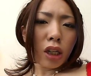 Lustful Japanese Ringo Akai fucks her shaved pussy with vibrator