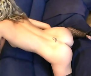Blonde busty babe rubs her naughty cunt and moans in delight