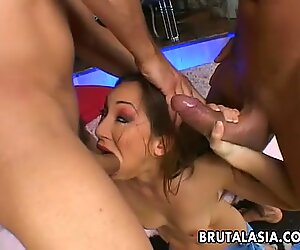 Enchanting Japanese girl fucked by two horny men