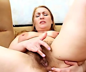 Mature slut fingering her pussy and asshole until she cums