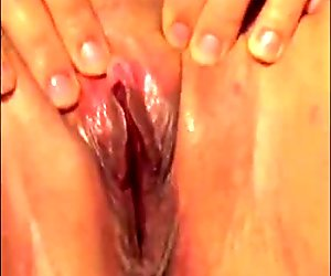 Fingering her shaved MILF pussy