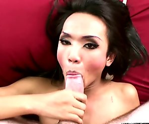 Attractive ladyboy eats thick dick all the way up to balls