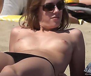 Very cute girl Topless on the Beach