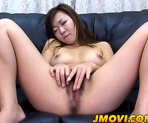 Asian babe exposes pussy in close up