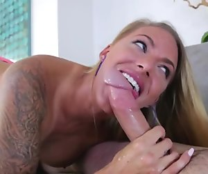 Tattooed busty step mom gives blowjob to big dick