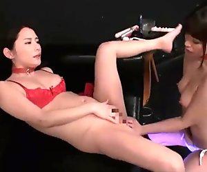 Japanese babe dominates submissive lesbian