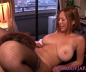 Asian mom in stockings slides cock in her boxReport this video