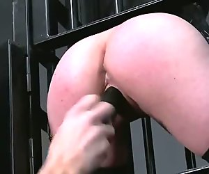 Busty blonde sub in cage gets pussy toyed and fucked