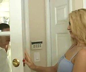 Tasty looking blond mommy Darryl Hanah seduces cute guy