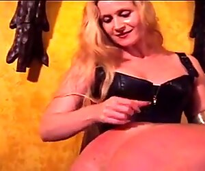 Mistress Amberle, paddling her slaves bumm