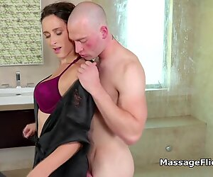 Slippery big tit masseuse plays with hard cock