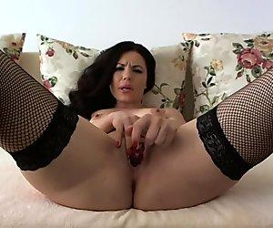 Sexy Brunette Fucks Her Glass Toy
