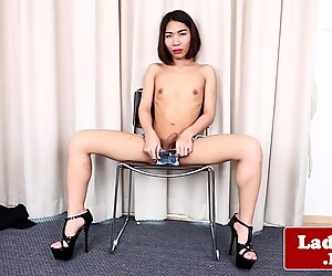 Solo ladyboy tugging her cock while teasing