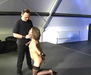 Helpless little slavegirl dressed sexy and played in bondage by dom male