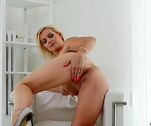 Blonde MILF with big tits plays with her tight pussy