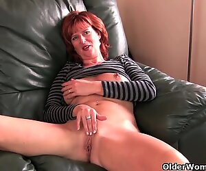 Mature redheaded mom masturbates on the couch